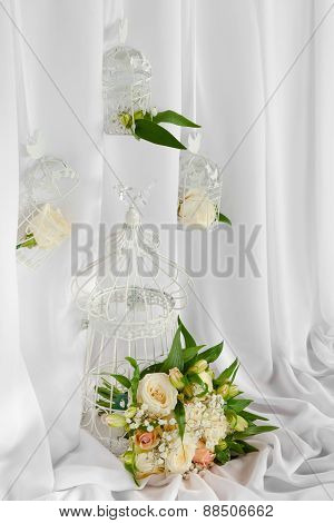 Vintage Cages With Flowers As Decoration On Wedding.