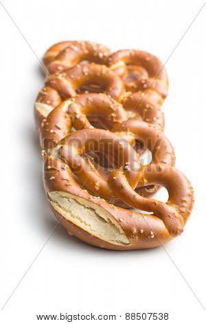 baked pretzels on white background