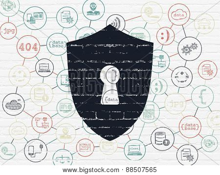 Privacy concept: Shield With Keyhole on wall background