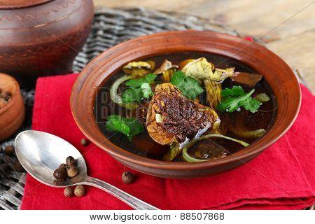 Mushroom soup on wicker man and color napkin, closeup