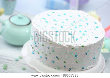 Birthday decorated cake on stand, closeup