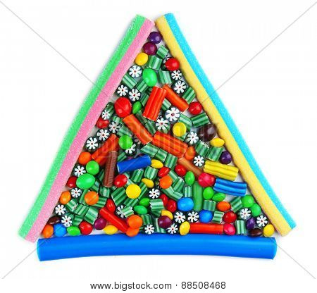 Colorful candies in shape of triangle isolated on white