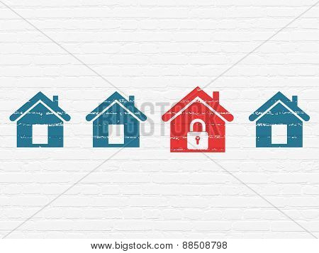 Security concept: red home icon on wall background