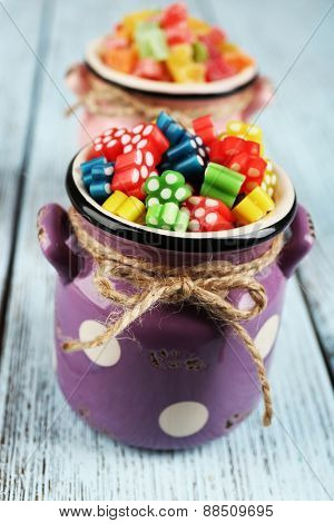 Sweet candies on wooden table, closeup
