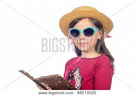 A Little Girl With Sun glasses Reads A Book