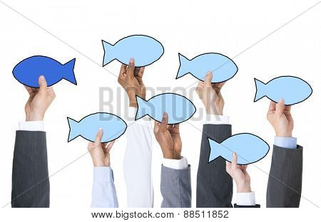 Business People Holding Fish Symbol and Contrasts Concept
