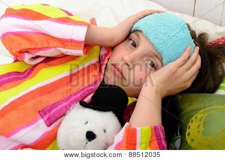 A Little Girl In Her Bed Has A Headache