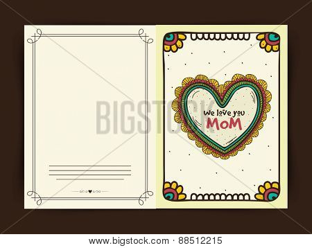 Floral decorated greeting card with text We Love You Mom for Happy Mother's Day celebration.