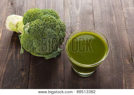 Top Shot Broccoli Juice On Wood Table.