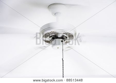 White ceiling electrical fan in motion