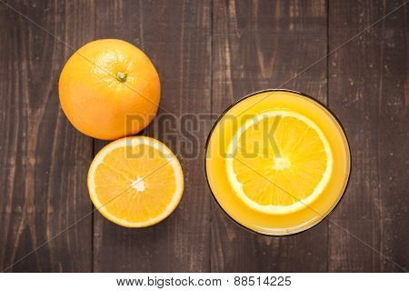 Top View Orange Juice On Wooden Background