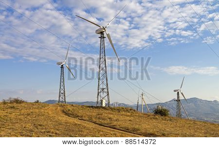 Three Wind Turbines On A Wind Farm. Crimea.