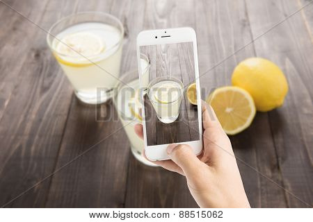 Taking Photo Of Freshly Squeezed Lemon Juice In Glasses.