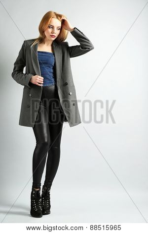 Expressive young model on gray background