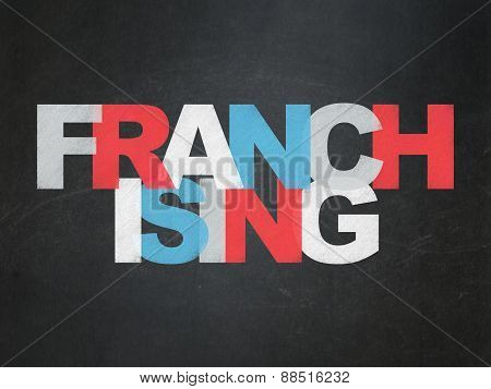 Finance concept: Franchising on School Board background