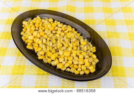 Sweet Canned Corn In Glass Dish On Tablecloth