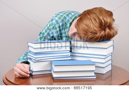 Tired woman and books