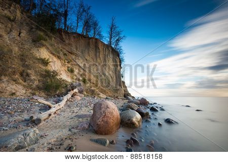 Beautiful Cliff On Sea Shore. Long Exposure Photo