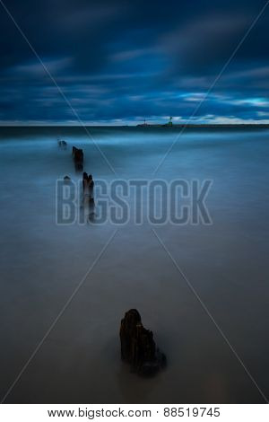Baltic coast with pier. Dark spooky long exposure photo