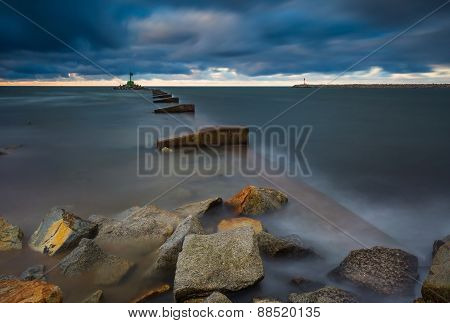 Long Exposure Seascape With Stone Breakwater