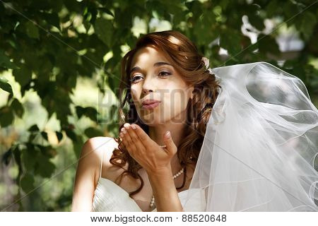 beautiful bride Blows a Kiss