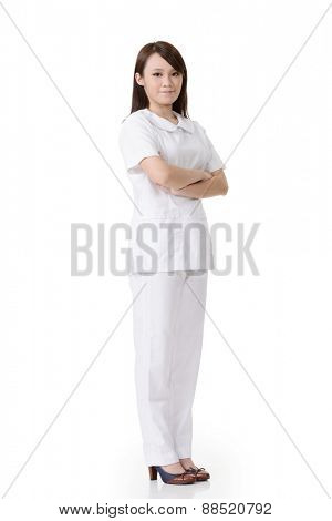 Full length portrait of Asian nurse with white clothes in white background.