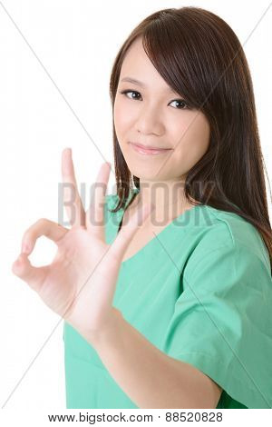 Asian woman of healthcare worker give you an ok sign on white background.