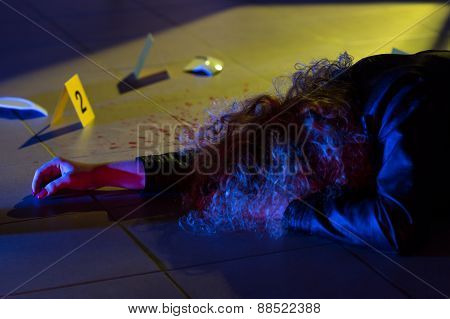 Dead Woman Lying On The Floor