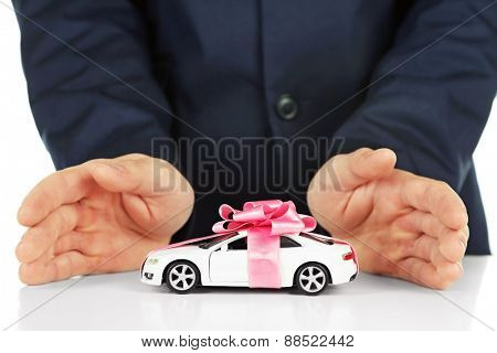 Man and model of car on table, closeup