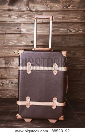 Suitcase on wooden background