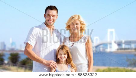 summer holidays, travel, tourism and people concept - happy family over rainbow bridge background