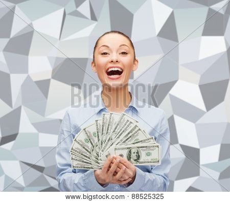 business, success, fortune and finances concept - young businesswoman with dollar cash money over gray graphic low poly background