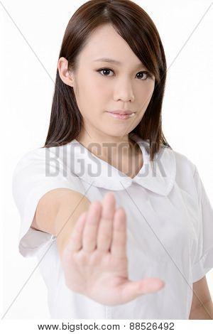 Asian nurse with give you a stop sign on white background.