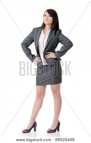 Confident business woman of Asian, full length portrait on white background.