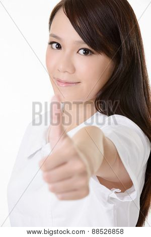 Asian nurse with give you an excellent sign on white background.
