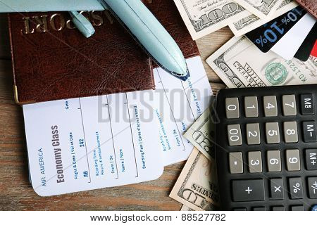 Airline tickets and documents on wooden table, closeup