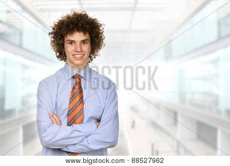 happy young man portrait at the office