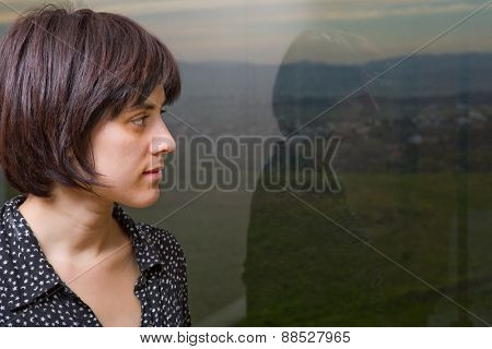 Portrait of a beautiful young woman thinking