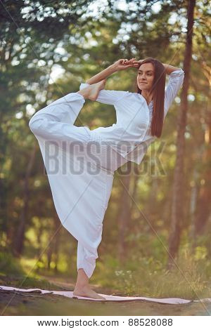 Flexible woman doing yoga exercise for stretching