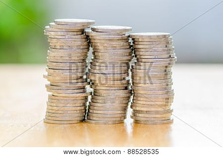 Stack Of Coin On Wood Table