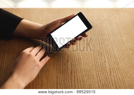 Woman hands holding smartphone