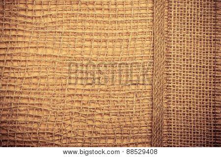 Jute Ribbon On Burlap Cloth Background