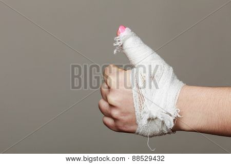 Hand Tied Elastic Bandage On Gray Background