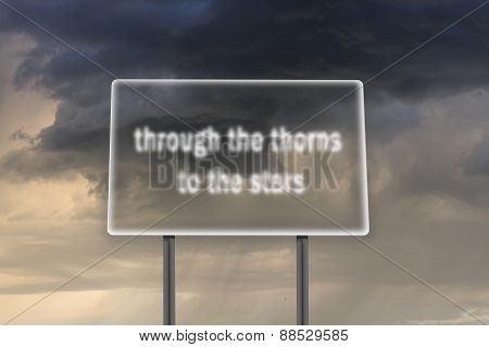 Billboard with inscription through the thorns to the stars