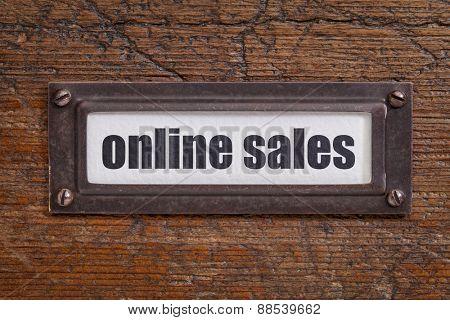 online sales  - file cabinet label, bronze holder against grunge and scratched wood