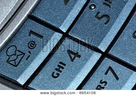 Mobile phone blue keyboard close view