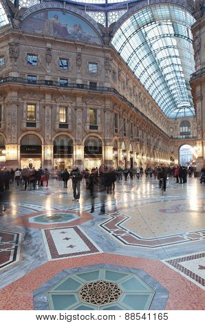 MILAN, ITALY - JANUARY 2, 2013: People in the Galleria Vittorio Emanuele II. Built by Giuseppe Mengoni in 1865-1877, it is one of the world oldest shopping malls
