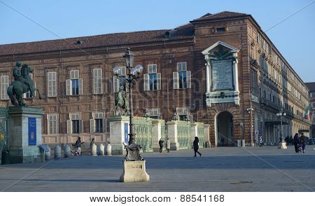 TURIN, ITALY - JANUARY 11, 2013: People on the Piazza Castello against the Royal Armory. Since 1997, it included in UNESCO World Heritage list as part of Residences of the Royal House of Savoy