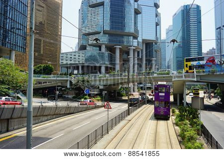 HONG KONG - APRIL 16, 2015: Double-decker trams on street of Hong Kong. Hong Kong tram is the only system in the world run with double deckers.