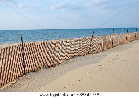 wooden fence on vacant beach